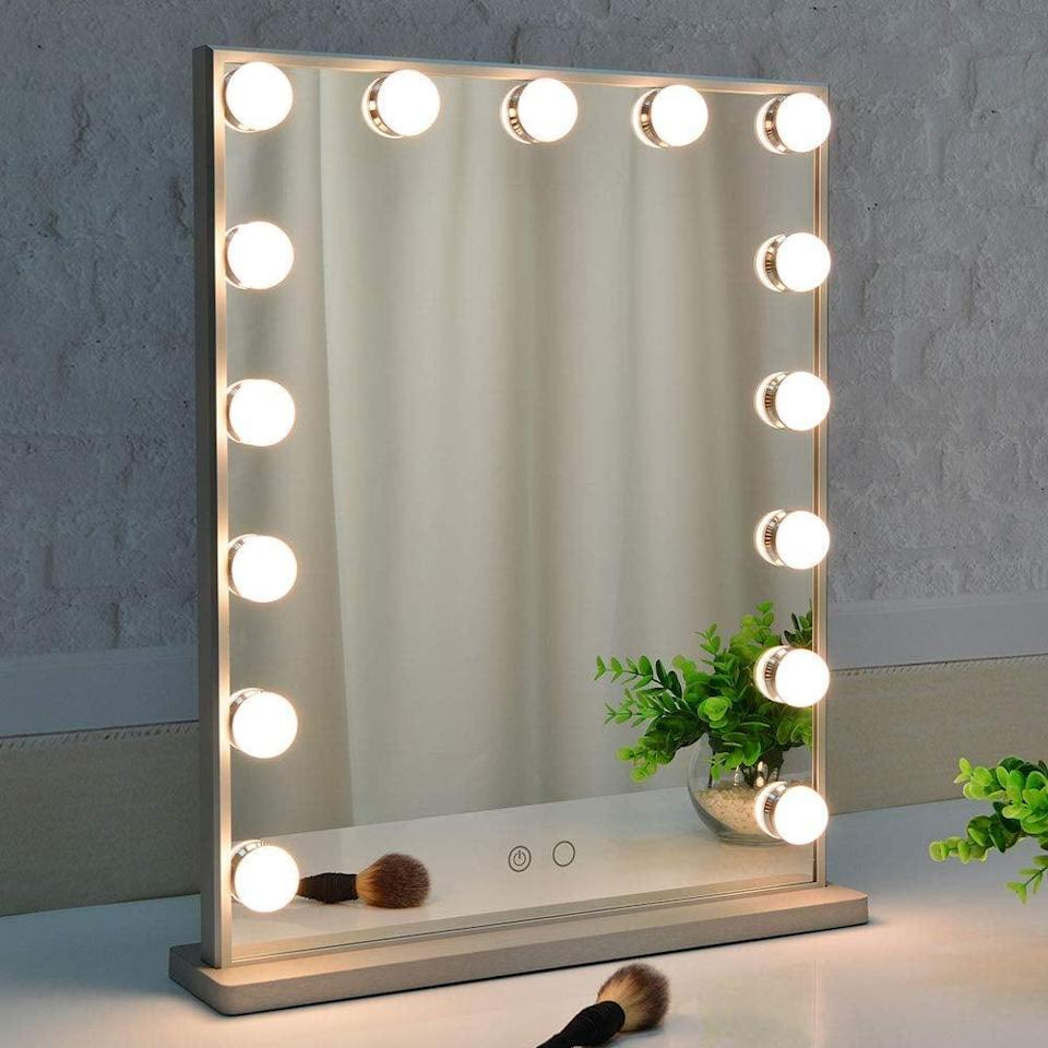 <p>Putting on makeup just got so much more fun thanks to this <span>Makeup Mirror with Lights</span> ($100).</p>