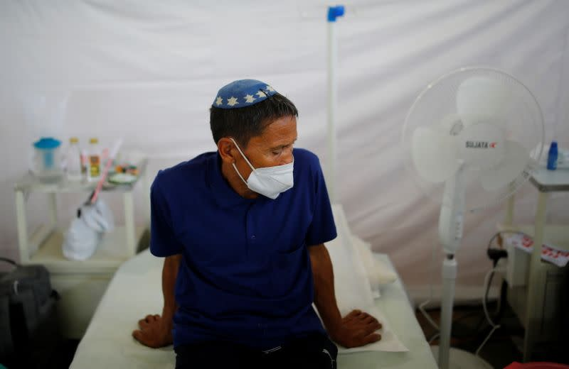 An Indian Jew, member of the Bnei Menashe, suffering from the coronavirus disease, rests at a COVID-19 care facility inside a Gurudwara or a Sikh Temple, in New Delhi