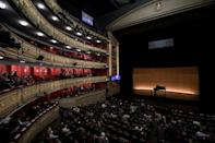 Spectators wait for the start of a performance at the Teatro Real in Madrid on January 14