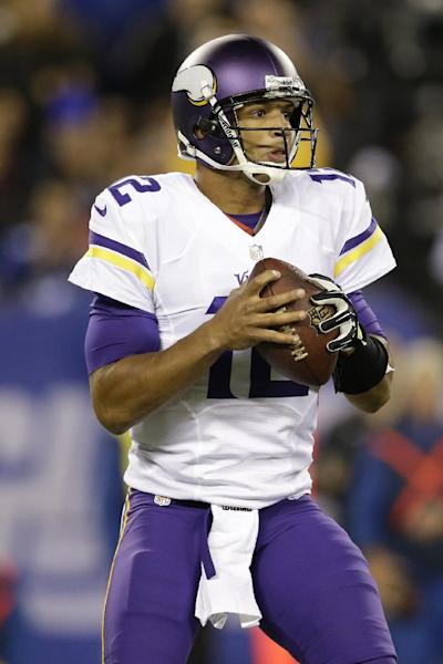 Minnesota Vikings quarterback Josh Freeman (12) looks to pass during the first half of an NFL football game against the New York Giants Monday, Oct. 21, 2013 in East Rutherford, N.J. (AP Photo/Julio Cortez)