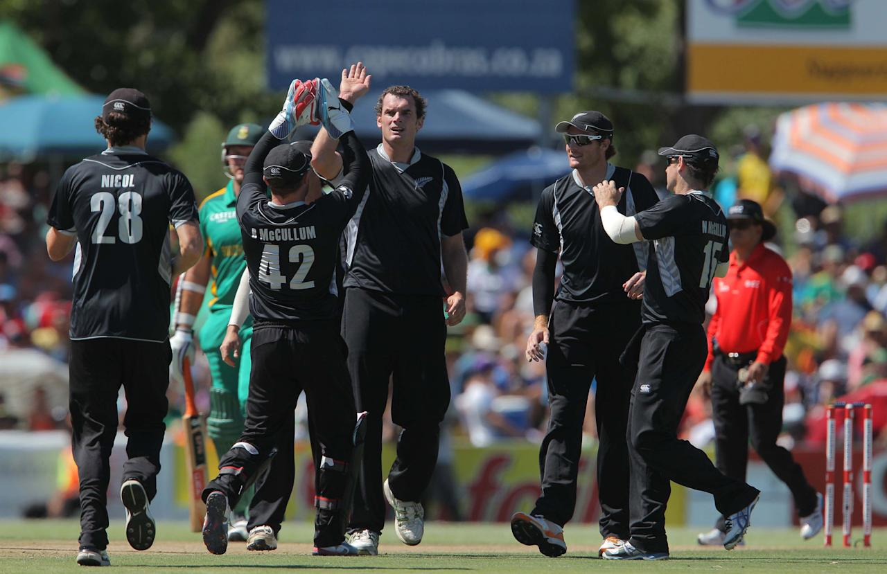 PAARL, SOUTH AFRICA - JANUARY 19:  Kyle Mills of New Zealand celebrates a wicket during the 1st One Day International match between South Africa and New Zealand at Boland Park on January 19, 2013 in Paarl, South Africa (Photo by Carl Fourie/Gallo Images/Getty Images)