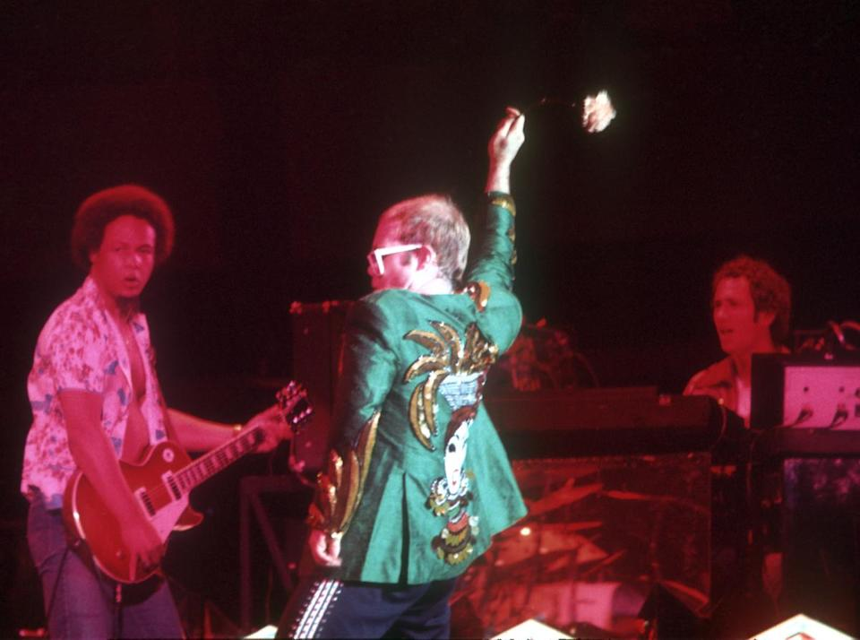 <p>Elton John in a fabulous bedazzled green blazer in 1974 (Photo: Getty Images) </p>