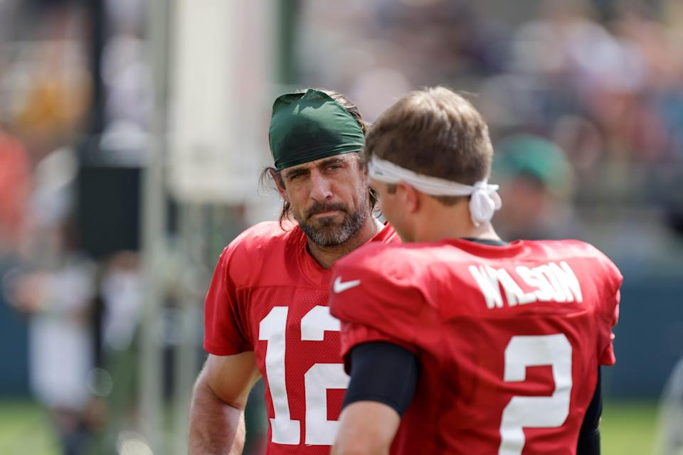 Green Bay Packers quarterback Aaron Rodgers (12) and New York Jets quarterback Zach Wilson (2) during a joint training camp practice on Wednesday.