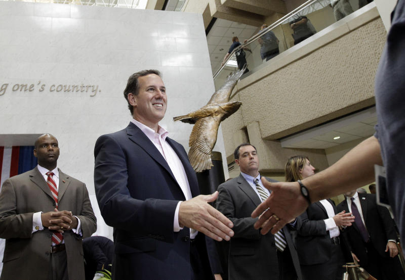 Republican presidential candidate, former Pennsylvania Sen. Rick Santorum shakes hands after speaking to USAA employees during a campaign stop at USAA, Thursday, March 22, 2012, in San Antonio. (AP Photo/Eric Gay)