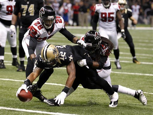 New Orleans Saints wide receiver Marques Colston (12) scores on a touchdown reception as Atlanta Falcons free safety Thomas DeCoud (28) covers in the second half of an NFL football game at Mercedes-Benz Superdome in New Orleans, Sunday, Nov. 11, 2012. (AP Photo/Bill Haber)
