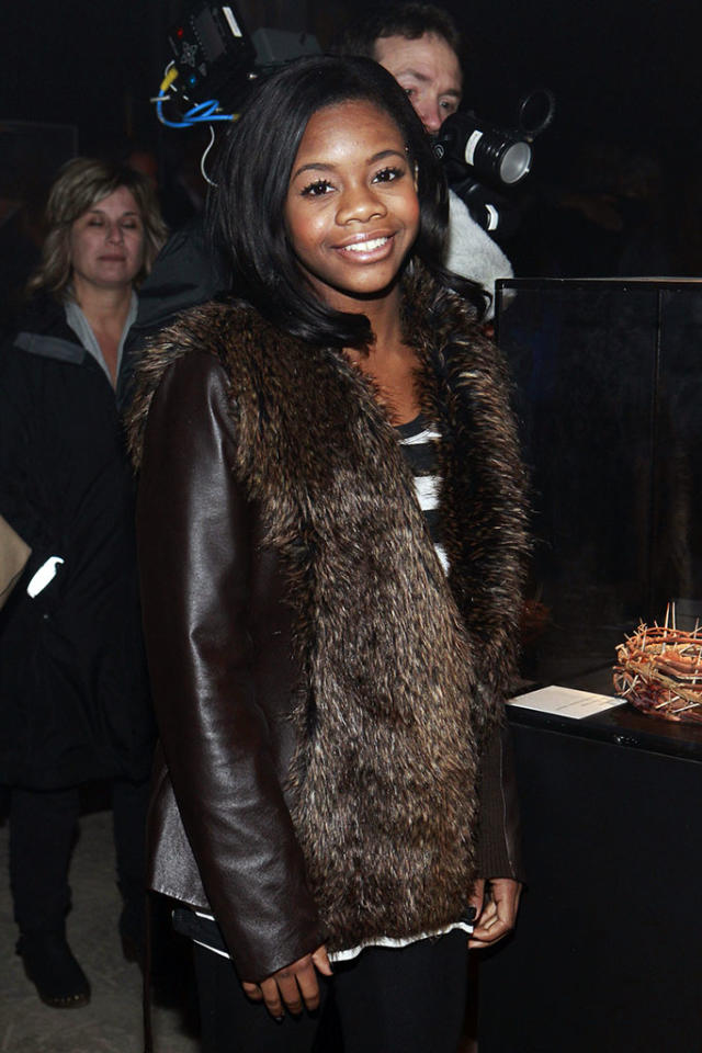 """Olympic gold medal winner Gaby Douglas arrives at """"The Bible Experience"""" opening night gala, a rare exhibit of biblical artifacts, in New York City on Tuesday, March 19 in New York."""