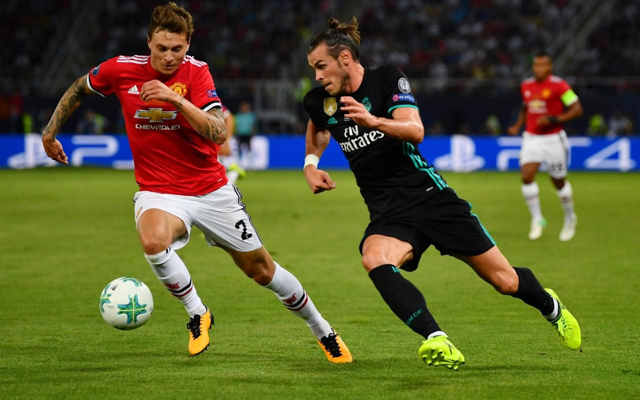 """Jose Mourinho is prepared to hold back Victor Lindelof in the same way he did Henrikh Mkhitaryan last season until the Manchester United manager is convinced the Sweden defender is ready to make the step up to Premier League football. Lindelof was omitted from United's 18-man squad for Sunday's comprehensive 4-0 win over West Ham United after Mourinho admitted the centre-half is finding the transition hard following his £30.7 million move from Benfica in June. Mourinho said he was forced to play Lindelof against his wishes in the European Super Cup defeat to Real Madrid last Tuesday, when the Swede struggled throughout, because of suspensions to Eric Bailly and Phil Jones but is now prepared to bide his time with the player, as he did with Mkhitaryan last term. Signed from Borussia Dortmund for £26.3 million last summer, the Armenia midfielder made just three substitute appearances and one start in the Premier League, when he was substituted at half-time of the 2-1 defeat by Manchester City last September, but was then not seen again in the competition until late November. Lindelof disappointed in United's pre-season matches and it has been noted internally that he has also looked sluggish at times in training. That contrasts with the success with which United's other summer signings, Romelu Lukaku and Nemanja Matic, both highly influential in the victory over West Ham, have begun their Old Trafford careers, but Mourinho believes their long-standing Premier League experience gives them a significant advantage over Lindelof. Henrikh Mkhitaryan (R) made a slow start to his United career """"I think Real Madrid was too early for him,"""" Mourinho said of Lindelof. """"He played because Jones and Bailly were both suspended. I've had players coming from different leagues to the Premier League and, normally, it's not easy. It's different for Lukaku and Matic as they have had years and years in the Premier League. """"I brought Ricardo Carvalho to Chelsea in 2004 and he was a phenomen"""