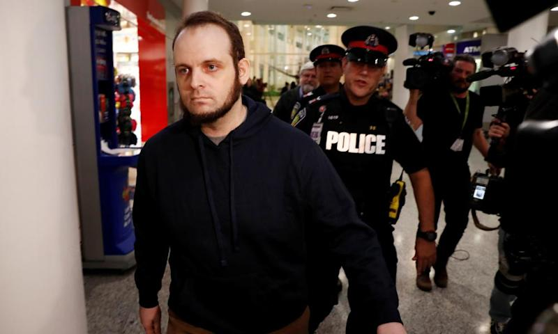 Joshua Boyle walks through the airport after arriving with his wife and three children in Toronto.