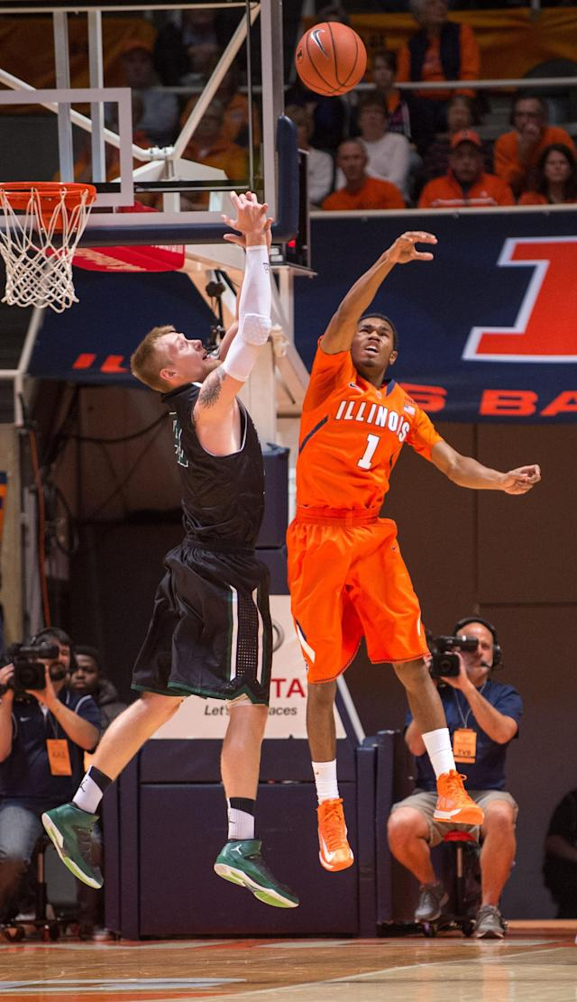 Illinois' Jaylon Tate (1) blocks a shot by Chicago State's Matt Ross, left, during the first half of an NCAA college basketball game on Friday, Nov. 22, 2013, in Champaign, Ill. (AP Photo/Darrell Hoemann)
