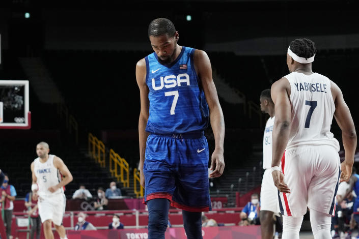United States' forward Kevin Durant (7) walks up the court during a men's basketball loss to France in a preliminary round game at the 2020 Summer Olympics, Sunday, July 25, 2021, in Saitama, Japan. (AP Photo/Eric Gay)