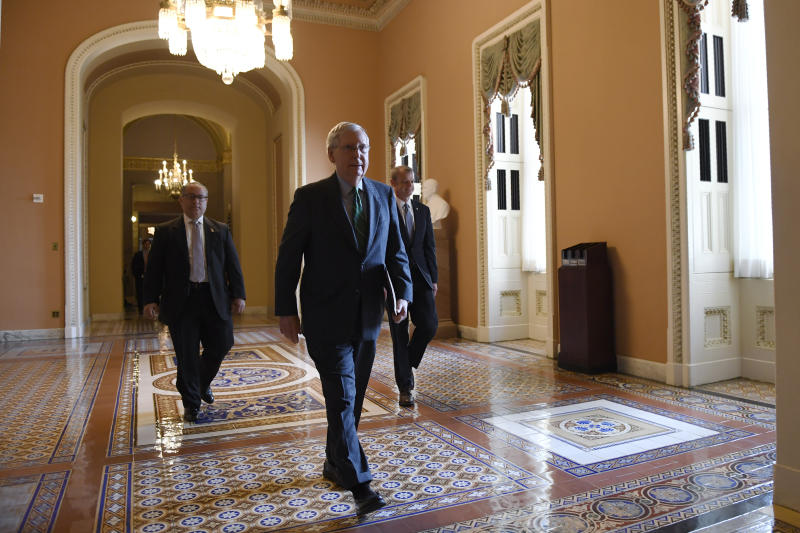 Senate Majority Leader Mitch McConnell of Ky., walks to the Senate floor on Capitol Hill in Washington, Thursday, March 19, 2020. (AP Photo/Susan Walsh)