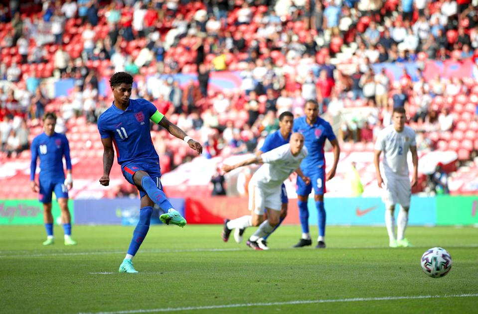 Marcus Rashford slots home from the penalty spot (PA Wire)