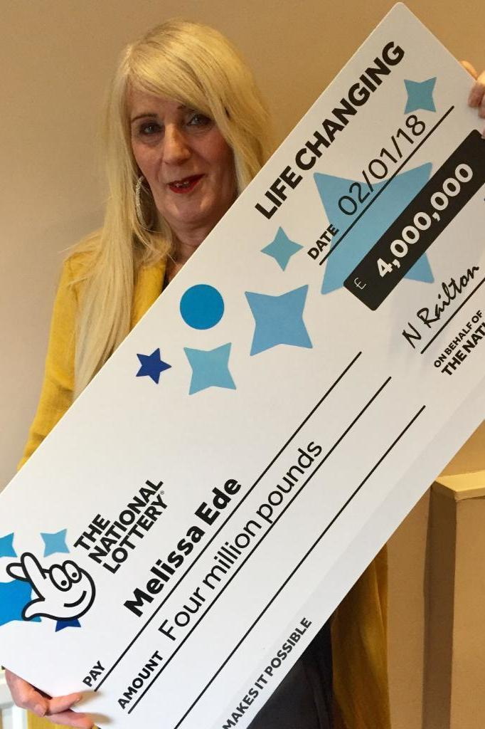 Taxi driver Melissa Ede, 57, with her £4 million win. (National Lottery)