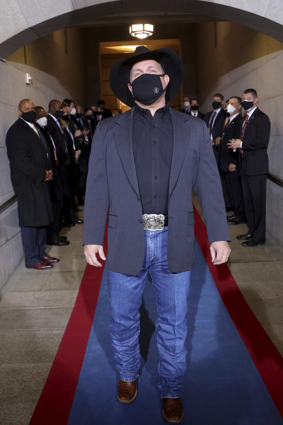 Garth Brooks arrives for the 59th Presidential Inauguration at the U.S. Capitol for President-elect Joe Biden in Washington, Wednesday, Jan. 20, 2021. (Win McNamee/Pool Photo via AP)