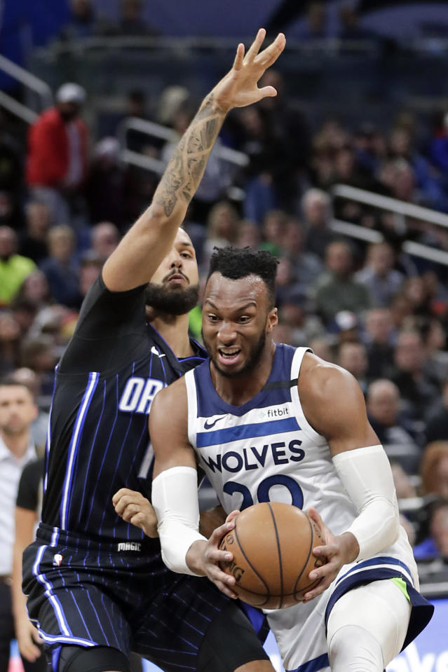 Minnesota Timberwolves guard Josh Okogie, right, tries to get around Orlando Magic guard Evan Fournier during the first half of an NBA basketball game Friday, Feb. 28, 2020, in Orlando, Fla. (AP Photo/John Raoux)
