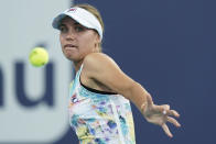 Sofia Kenin returns a shot from Andrea Petkovic, of Germany, during the Miami Open tennis tournament, Friday, March 26, 2021, in Miami Gardens, Fla. (AP Photo/Wilfredo Lee)