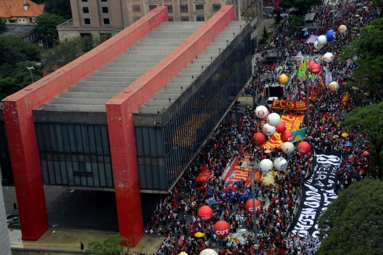 """Large crowds gathered in Rio de Janeiro, Sao Paulo (pictured), Brasilia and more than 160 other towns and cities as part of the """"Bolsonaro Out National Campaign,"""" which is backed by a dozen left-wing political parties and labor groups (AFP/NELSON ALMEIDA)"""