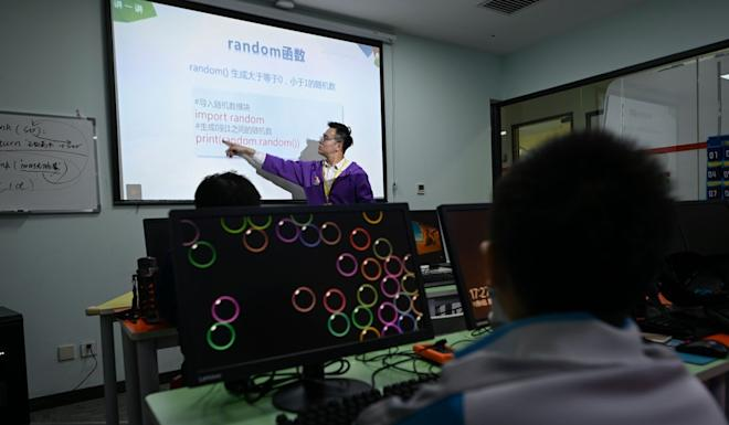 A trainer takes a class at a children's coding training centre in Beijing. The training centres are booming thanks to demand from middle-class families. Photo: AFP