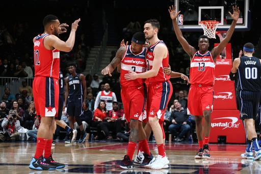 WASHINGTON, DC - MARCH 13: Bradley Beal #3 of the Washington Wizards congratulated by teammates after play against the Orlando Magic on March 13, 2019 at Capital One Arena in Washington, DC. (Photo by Stephen Gosling/NBAE via Getty Images)