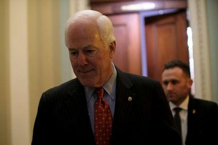FILE PHOTO: U.S. Senate Majority Whip John Cornyn (R-TX) walks from his office to the Senate floor during debate over the Republican tax reform plan in Washington, U.S., December 1, 2017. REUTERS/James Lawler Duggan