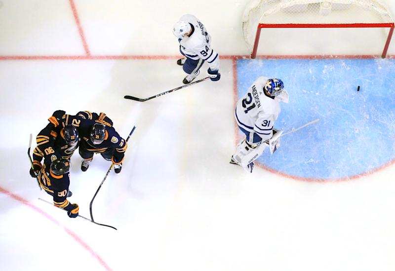 BUFFALO, NY - FEBRUARY 16: Johan Larsson #22 of the Buffalo Sabres celebrates his goal with teammates during an NHL game against the Toronto Maple Leafs on February 16, 2020 at KeyBank Center in Buffalo, New York. (Photo by Bill Wippert/NHLI via Getty Images)
