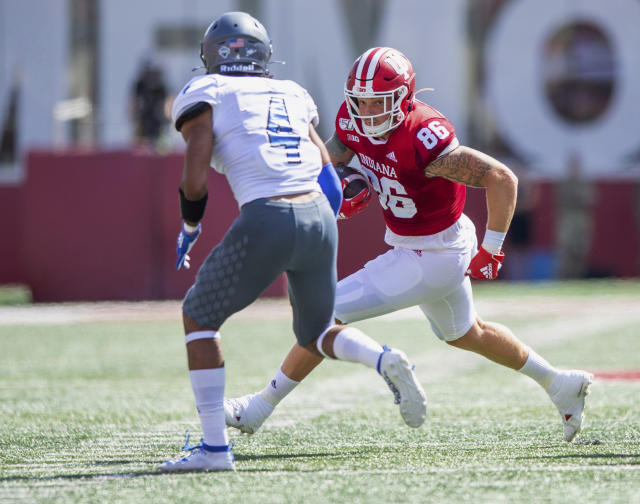 Indiana tight end Peyton Hendershot (86) takes the ball into the defense of Eastern Illinois safety Raymond Crittenden (4) during the first half of an NCAA college football game Saturday, Sept. 7, 2019, in Bloomington, Ind. (AP Photo/Doug McSchooler)