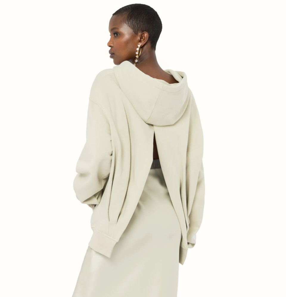 """<p><strong>Fenty</strong></p><p>fenty.com</p><p><strong>$280.00</strong></p><p><a href=""""https://www.fenty.com/us/en/products/shirts-dresses-open-back-hoodie-light-opaline-m/101970.html"""" rel=""""nofollow noopener"""" target=""""_blank"""" data-ylk=""""slk:Shop Now"""" class=""""link rapid-noclick-resp"""">Shop Now</a></p><p>A neutral hoodie is a must-own in everyone's closet. This one gets a modern twist, with a cool open back slit. </p>"""