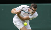 Poland's Hubert Hurkacz plays a return to Italy's Matteo Berrettini during the men's singles semifinals match on day eleven of the Wimbledon Tennis Championships in London, Friday, July 9, 2021. (AP Photo/Kirsty Wigglesworth)