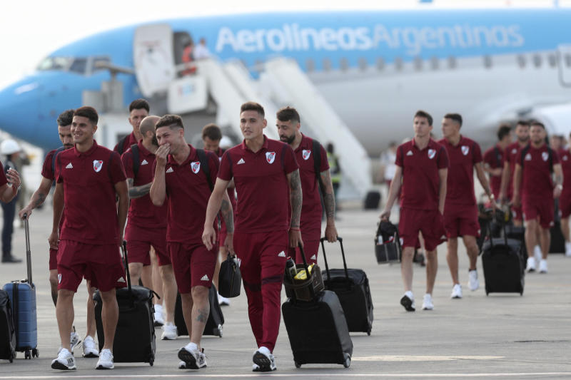 Argentina's River Plate soccer team walks on the airport tarmac after arriving to the military airport Grupo Aereo 8, in Lima, Peru, Wednesday, Nov. 20, 2019. The team will play Brazil's Flamengo on Saturday's Copa Libertadores final. (AP Photo/Martin Mejia)