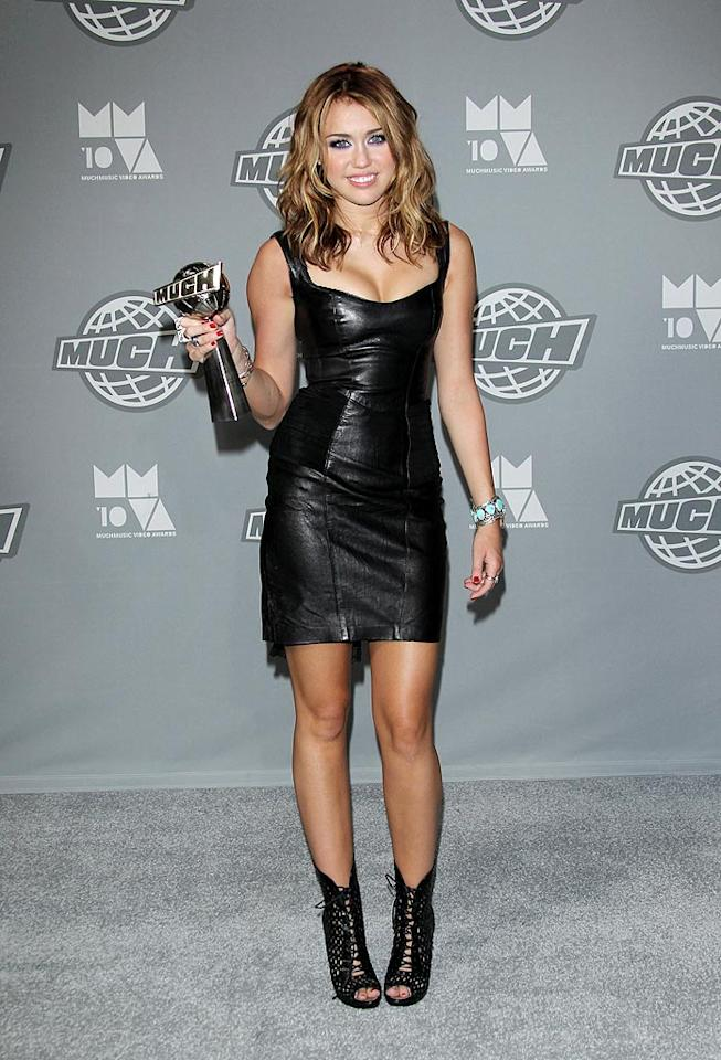 """Love her or hate her, there's no denying Miley's ability to present herself well at award shows. The tween queen picked up an award for International Video Of The Year for """"Party In The USA"""" while wearing a tight leather dress and lace-up Alaia booties. George Pimentel/<a href=""""http://www.wireimage.com"""" target=""""new"""">WireImage.com</a> - June 20, 2010"""