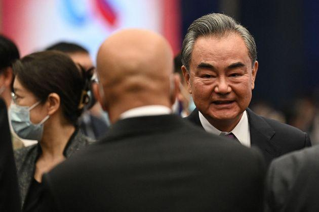Chinese Foreign Minister Wang Yi (R) chats with guests after the opening ceremony of the Lanting Forum in Beijing on June 25, 2021. (Photo by Jade GAO / AFP) (Photo by JADE GAO/AFP via Getty Images) (Photo: JADE GAO via Getty Images)