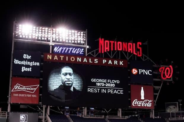 An image honouring George Floyd is shown on the scoreboard after a game between the St. Louis Cardinals and Washington Nationals at Nationals Park on April 20.