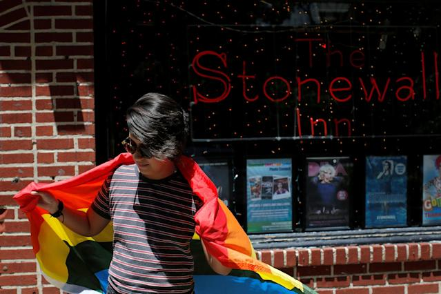 <p>Cameron Cano of Miami, Florida stands outside the Stonewall Inn on Christopher Street, considered by some as the center of New York State's gay rights movement, following the shooting massacre at Orlando's Pulse nightclub, in the Manhattan borough of New York, June 12, 2016. (REUTERS/Andrew Kelly ) </p>