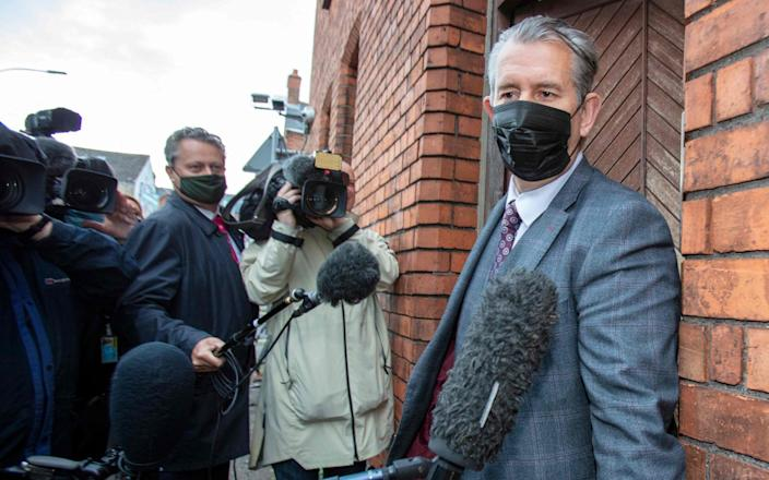 Edwin Poots leaves the party headquarters in Belfast on June 17 - Paul Faith/AFP