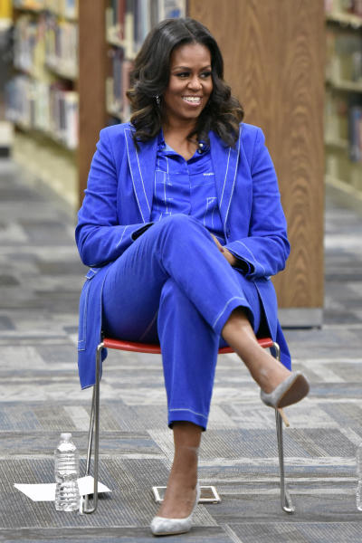 "Former first lady Michelle Obama speaks with students about her upcoming book ""Becoming"" during a roundtable discussion at Whitney M. Young Magnet High School, on Monday, Nov 12, 2018, in Chicago. (Photo by Rob Grabowski/Invision/AP)"