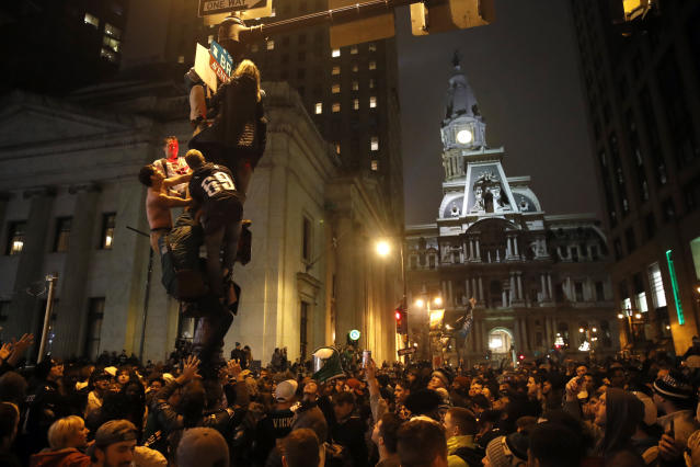 <p>Philadelphia Eagles fans celebrate the team's victory in NFL Super Bowl 52 between the Philadelphia Eagles and the New England Patriots, Sunday, Feb. 4, 2018, in downtown Philadelphia. (AP Photo/Matt Rourke) </p>
