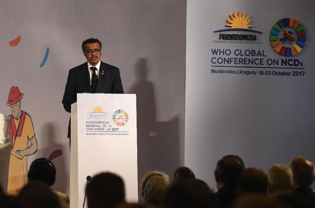 WHO head Tedros Adhanom Ghebreyesus had praised Zimbabwe's health coverage -- but announced a rethink after critics observed its president tends to get his treatment abroad (AFP Photo/MIGUEL ROJO)