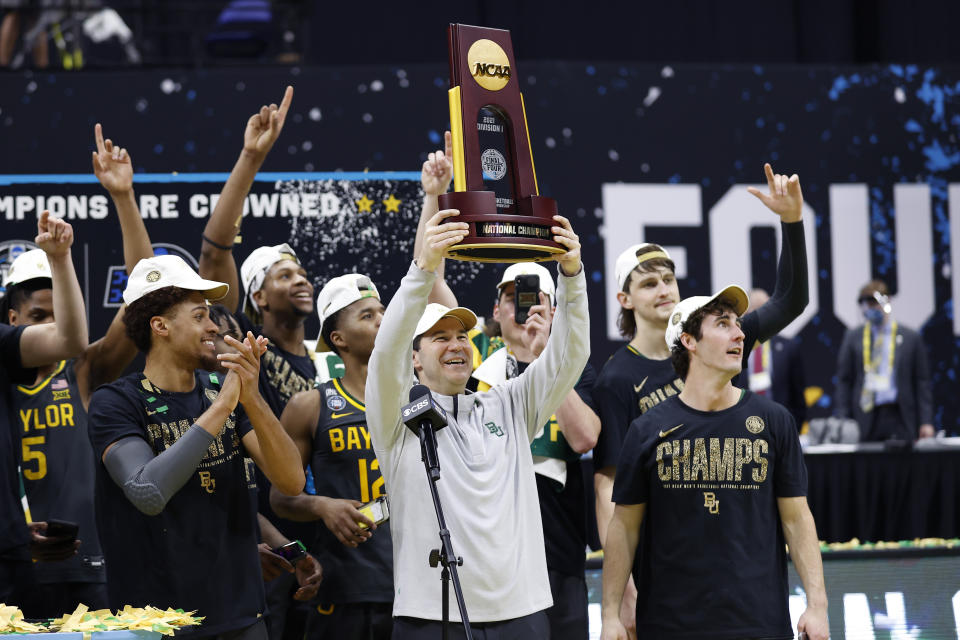 INDIANAPOLIS, INDIANA - APRIL 05: Head coach Scott Drew of the Baylor Bears holds up the trophy after defeating the Gonzaga Bulldogs 86-70 in the National Championship game of the 2021 NCAA Men's Basketball Tournament at Lucas Oil Stadium on April 05, 2021 in Indianapolis, Indiana. (Photo by Jamie Squire/Getty Images)