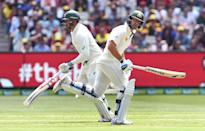 Australia's Usman Khawaja (L) and Joe Burns both scored centuries on the first day of the second Test against the West Indies in Melbourne on December 26, 2015 (AFP Photo/William West)