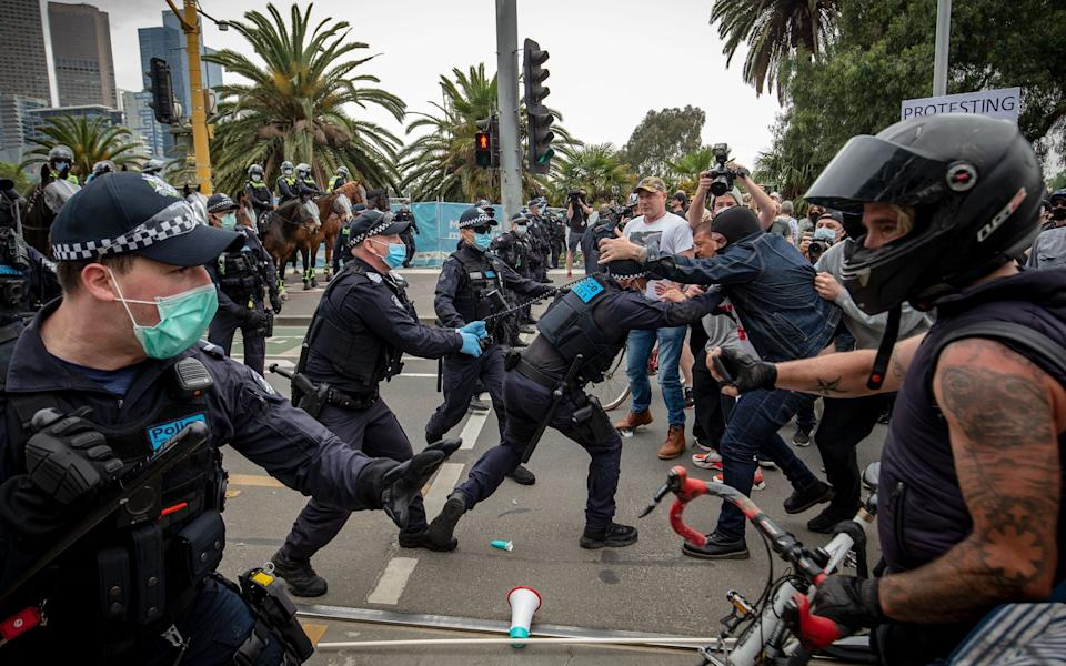Protesters and members of Victoria Police clash - Getty