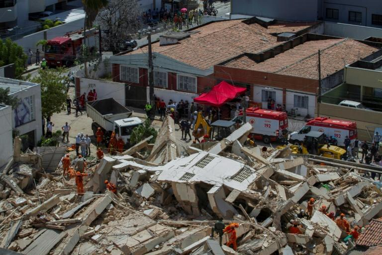 Firefighters search for survivors after a seven-story residential building collapsed in Fortaleza,  Brazil, on October 15, 2019