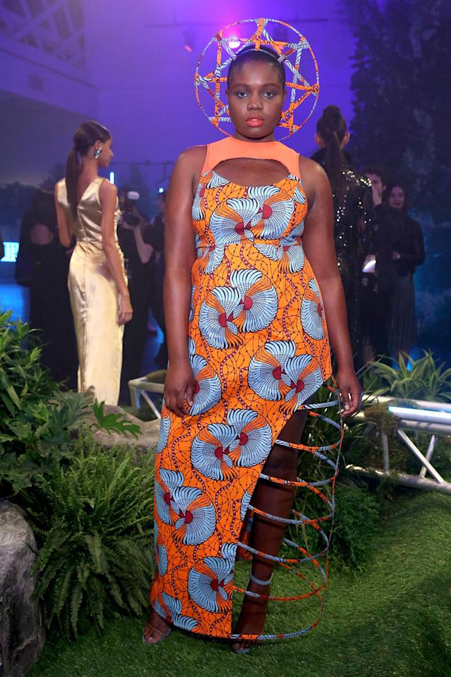 <p>Model wears a besoke dress design by Tolu Aremu and Becca McCharren of Chromat at the Black Panther Welcome to Wakanda NYFW fashion presentation. (Photo: Courtesy of Marvel Studios Black Panther/Getty) </p>