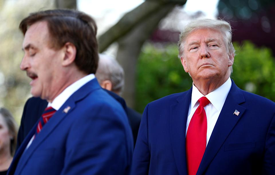 My Pillow CEO Michael Lindell speaks as U.S. President Donald Trump listens during the daily coronavirus (COVID-19) response briefing in the Rose Garden at the White House in Washington, U.S., March 30, 2020. REUTERS/Tom Brenner