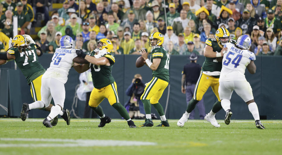 Green Bay Packers quarterback Aaron Rodgers (12) looks to throw the ball against the Detroit Lions during an NFL football game Monday, Sept 20. 2021, in Green Bay, Wis. (AP Photo/Jeffrey Phelps)