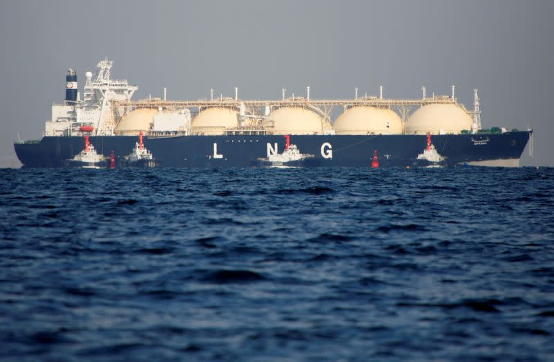 FILE PHOTO: An LNG tanker is tugged towards a thermal power station in Futtsu