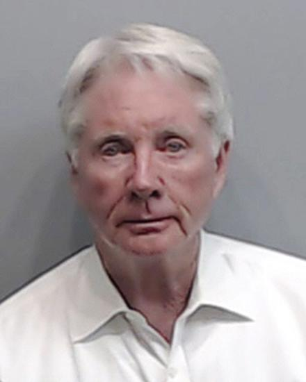 Attorney who said he shot wife by accident is indicted