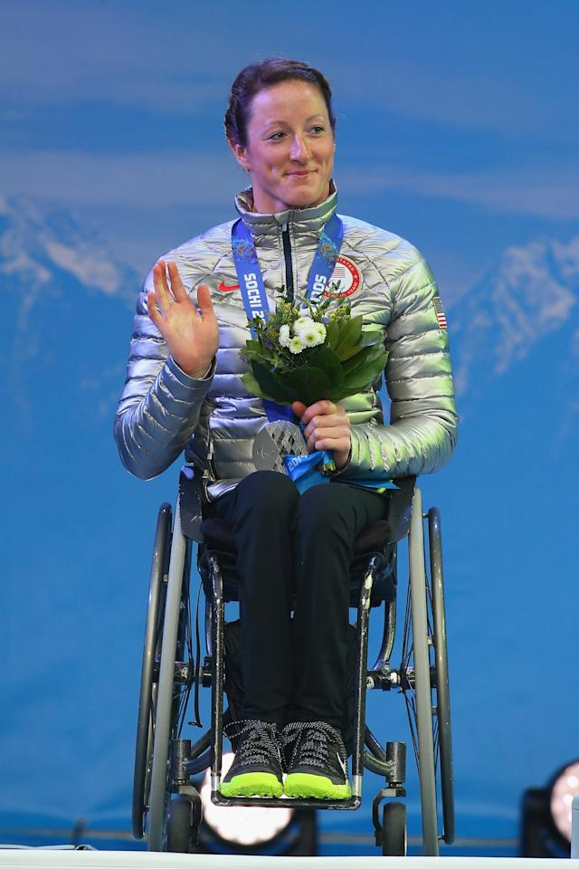 SOCHI, RUSSIA - MARCH 13: Silver medalist Tatyana McFadden of the United States celebrates on the podium during the medal ceremony for the women's 1km sprint, sitting cross-country during day six of Sochi 2014 Paralympic Winter Games at Rosa Khutor Alpine Center on March 13,2014 in Sochi, Russia. (Photo by Mark Kolbe/Getty Images)