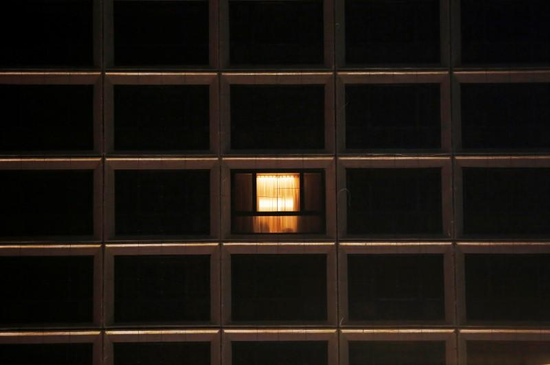 A window with lights on is seen at a hotel, following the coronavirus disease (COVID-19) outbreak, in Hong Kong
