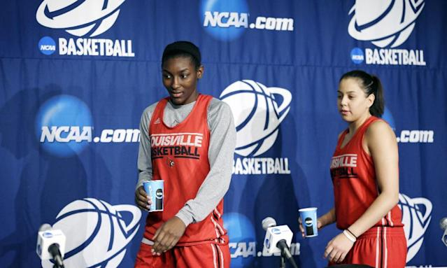 Louisville's Asia Taylor, left, and Shoni Schimmel walk to the podium before a news conference for the NCAA women's college basketball tournament, Monday, March 24, 2014, in Iowa City, Iowa. Louisville plays Iowa in a second-round game on Tuesday. (AP Photo/Charlie Neibergall)