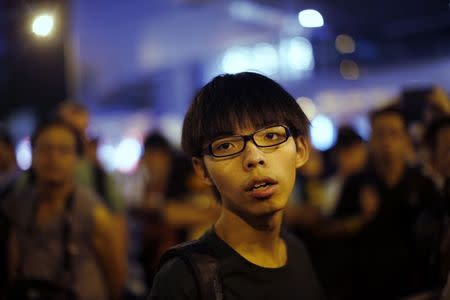 Joshua Wong, leader of the student movement, pauses as he talks to reporters outside the government headquarters office in Hong Kong in this October 9, 2014 file photo. REUTERS/Carlos Barria/Files